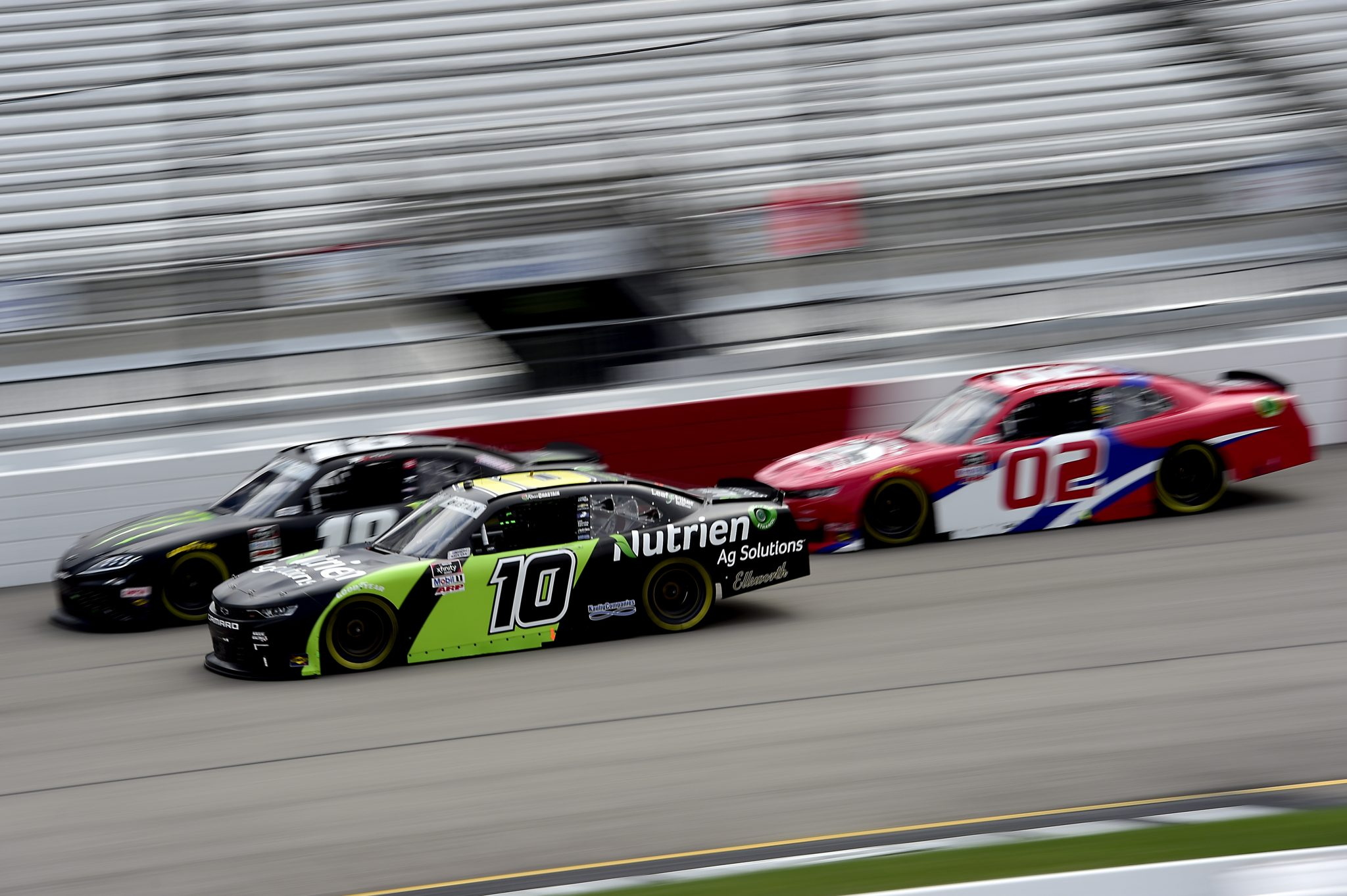 RICHMOND, VIRGINIA - SEPTEMBER 12: Ross Chastain, driver of the #10 Nutrien Ag Solutions Chevrolet, Riley Herbst, driver of the #18 Monster Energy Toyota, and Brett Moffitt, driver of the #02 Robert B Our Inc Co Chevrolet, race during the NASCAR Xfinity Series Virginia is for Racing Lovers 250 at Richmond Raceway on September 12, 2020 in Richmond, Virginia. (Photo by Jared C. Tilton/Getty Images) | Getty Images