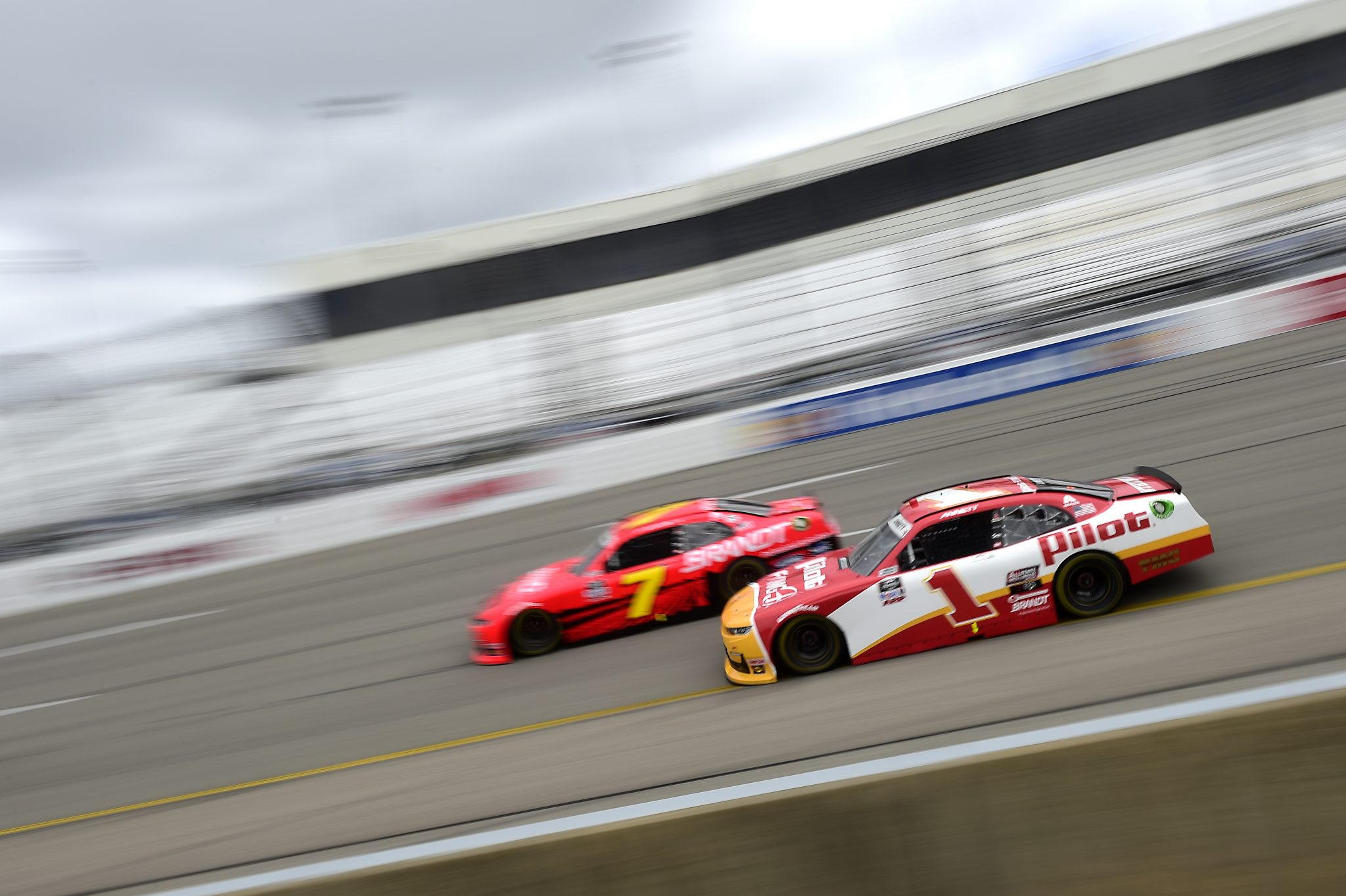 RICHMOND, VIRGINIA - SEPTEMBER 12: Michael Annett, driver of the #1 Pilot Flying J Chevrolet, and Justin Allgaier, driver of the #7 BRANDT Chevrolet, race during the NASCAR Xfinity Series Virginia is for Racing Lovers 250 at Richmond Raceway on September 12, 2020 in Richmond, Virginia. (Photo by Jared C. Tilton/Getty Images) | Getty Images