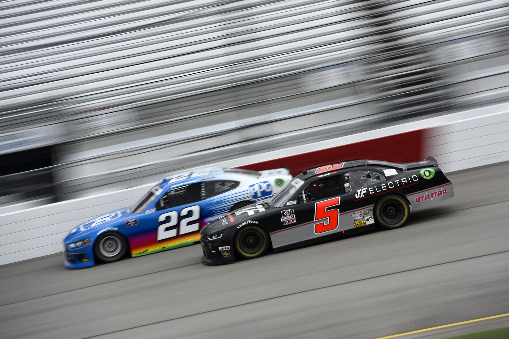 RICHMOND, VIRGINIA - SEPTEMBER 12: Matt Mills, driver of the #5 J.F. Electric Chevrolet, and Austin Cindric, driver of the #22 PPG Ford, race during the NASCAR Xfinity Series Virginia is for Racing Lovers 250 at Richmond Raceway on September 12, 2020 in Richmond, Virginia. (Photo by Jared C. Tilton/Getty Images) | Getty Images