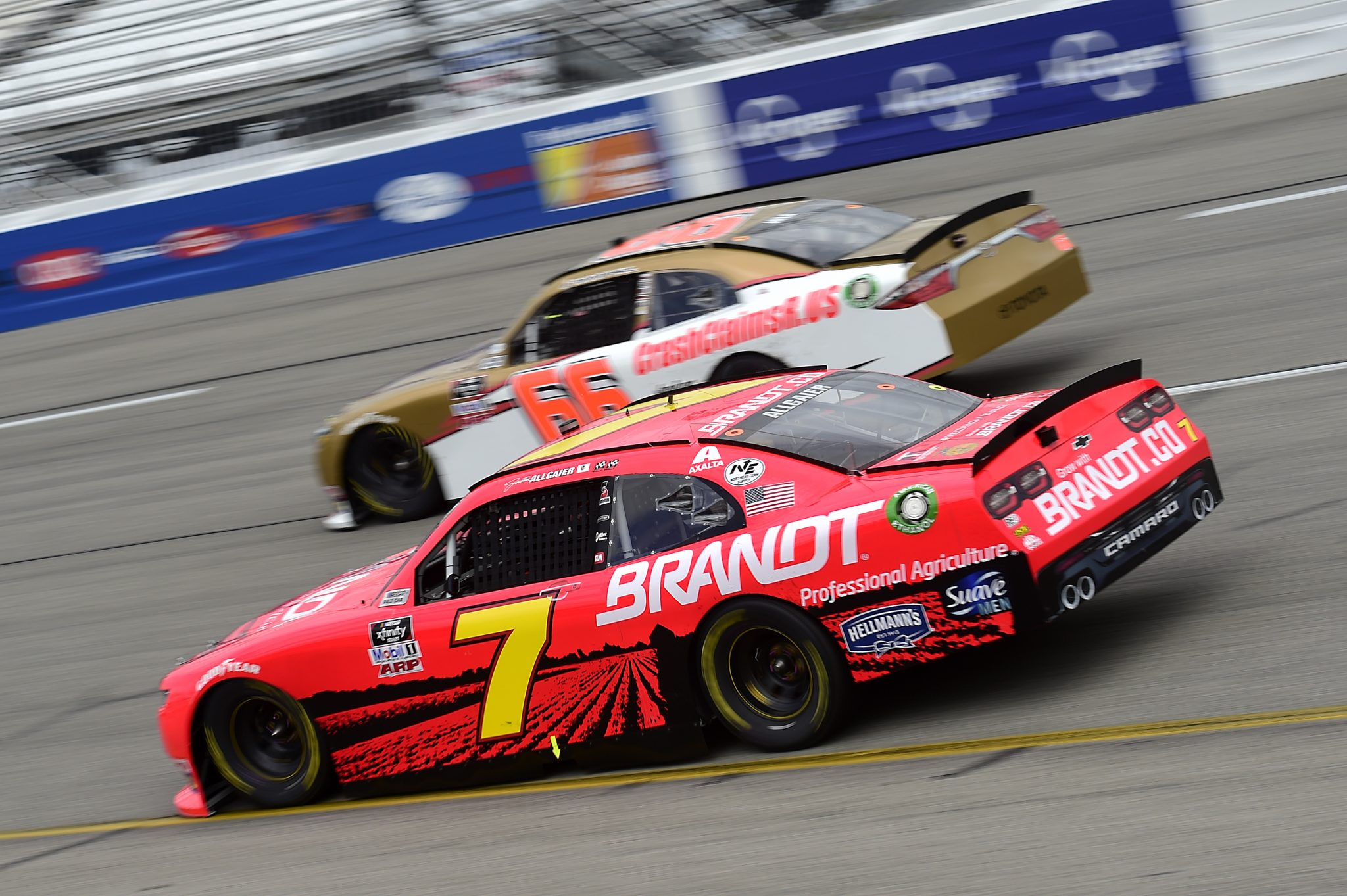 RICHMOND, VIRGINIA - SEPTEMBER 12: Justin Allgaier, driver of the #7 BRANDT Chevrolet, and Timmy Hill, driver of the #66 CRASHCLAIMSR.US Toyota, race during the NASCAR Xfinity Series Virginia is for Racing Lovers 250 at Richmond Raceway on September 12, 2020 in Richmond, Virginia. (Photo by Jared C. Tilton/Getty Images) | Getty Images