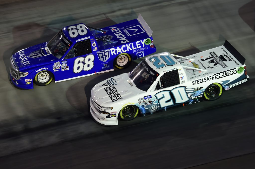 BRISTOL, TENNESSEE - SEPTEMBER 17: Spencer Boyd, driver of the #20 Steelsafe Shelters Chevrolet, and Clay Greenfield, driver of the #68 Rackley Roofing Toyota, drives during the NASCAR Gander RV & Outdoors Truck Series UNOH 200 presented by Ohio Logistics at Bristol Motor Speedway on September 17, 2020 in Bristol, Tennessee. (Photo by Jared C. Tilton/Getty Images) | Getty Images