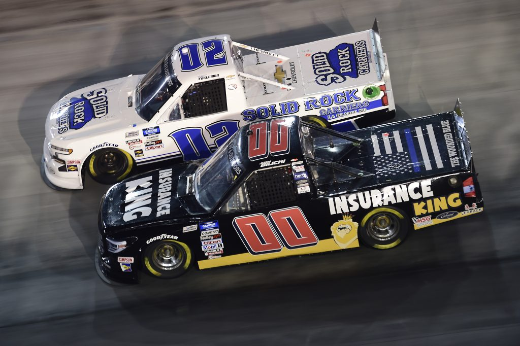 BRISTOL, TENNESSEE - SEPTEMBER 17: Josh Bilicki, driver of the #00 Insurance King Toyota, and Tate Fogleman, driver of the #02 Solid Rock Carriers Chevrolet, race during the NASCAR Gander RV & Outdoors Truck Series UNOH 200 presented by Ohio Logistics at Bristol Motor Speedway on September 17, 2020 in Bristol, Tennessee. (Photo by Jared C. Tilton/Getty Images) | Getty Images