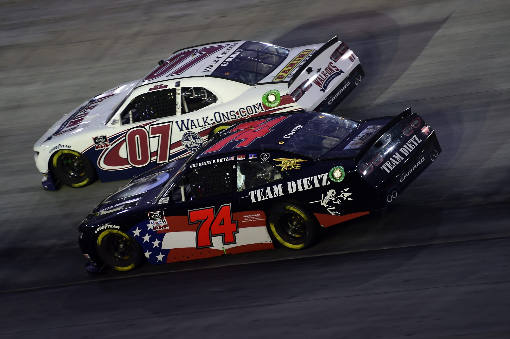 BRISTOL, TENNESSEE - SEPTEMBER 18: Bayley Currey, driver of the #74 Team Dietz Chevrolet, and Gray Gaulding, driver of the #07 WALK-ON'S Chevrolet, race during the NASCAR Xfinity Series Food City 300 at Bristol Motor Speedway on September 18, 2020 in Bristol, Tennessee. (Photo by Jared C. Tilton/Getty Images) | Getty Images
