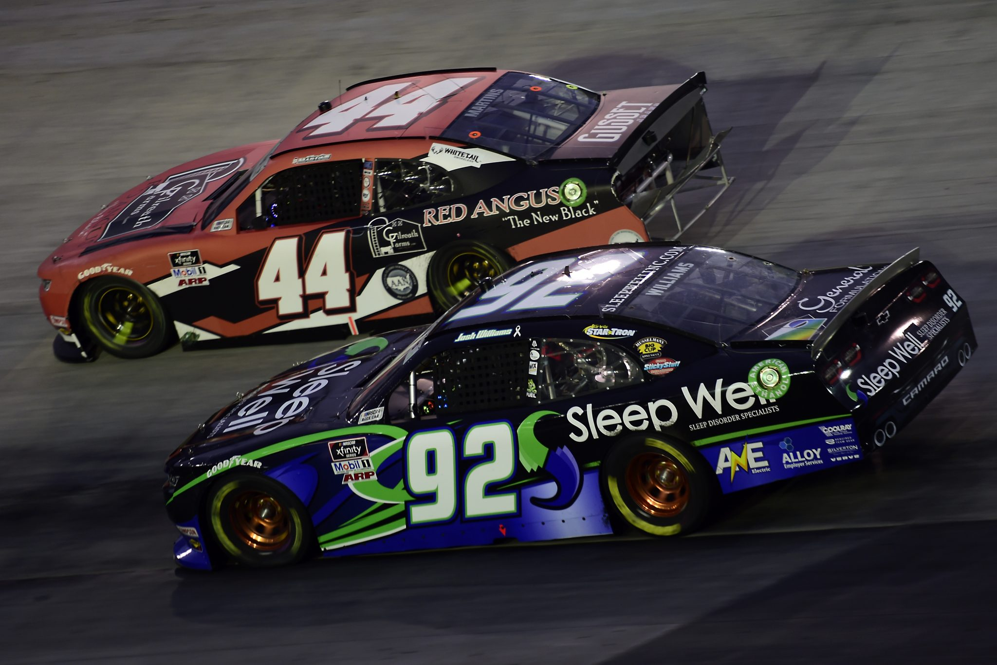 BRISTOL, TENNESSEE - SEPTEMBER 18: Josh Williams, driver of the #92 Sleep Well Chevrolet, and Tommy Joe Martins, driver of the #44 Gilreath Farms Red Angus Chevrolet, race during the NASCAR Xfinity Series Food City 300 at Bristol Motor Speedway on September 18, 2020 in Bristol, Tennessee. (Photo by Jared C. Tilton/Getty Images) | Getty Images