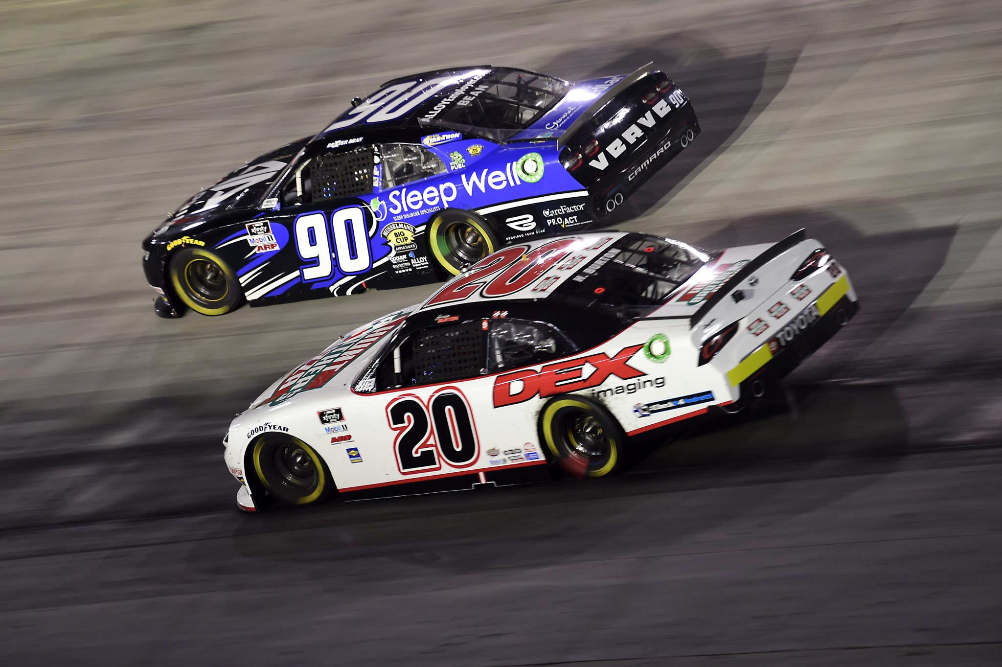 BRISTOL, TENNESSEE - SEPTEMBER 18: Harrison Burton, driver of the #20 Hunt Brothers Pizza/DEX Imaging Toyota, and Dexter Bean, driver of the #90 Sleep Well/Alpha Prime Chevrolet, race during the NASCAR Xfinity Series Food City 300 at Bristol Motor Speedway on September 18, 2020 in Bristol, Tennessee. (Photo by Jared C. Tilton/Getty Images) | Getty Images