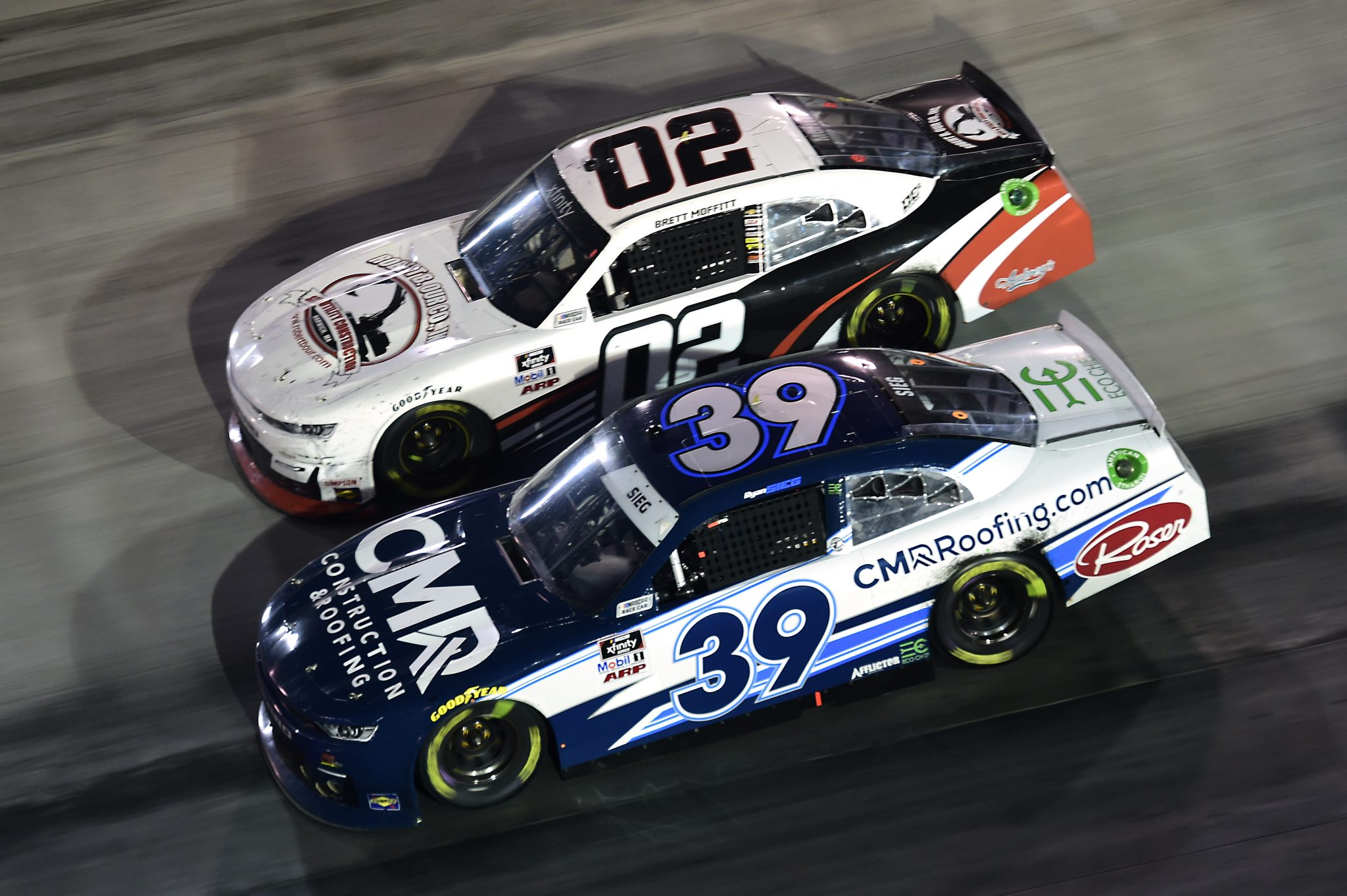 BRISTOL, TENNESSEE - SEPTEMBER 18: Ryan Sieg, driver of the #39 CMRRoofing.com Chevrolet, and Brett Moffitt, driver of the #02 Robert B Our Inc Co Chevrolet, race during the NASCAR Xfinity Series Food City 300 at Bristol Motor Speedway on September 18, 2020 in Bristol, Tennessee. (Photo by Jared C. Tilton/Getty Images) | Getty Images