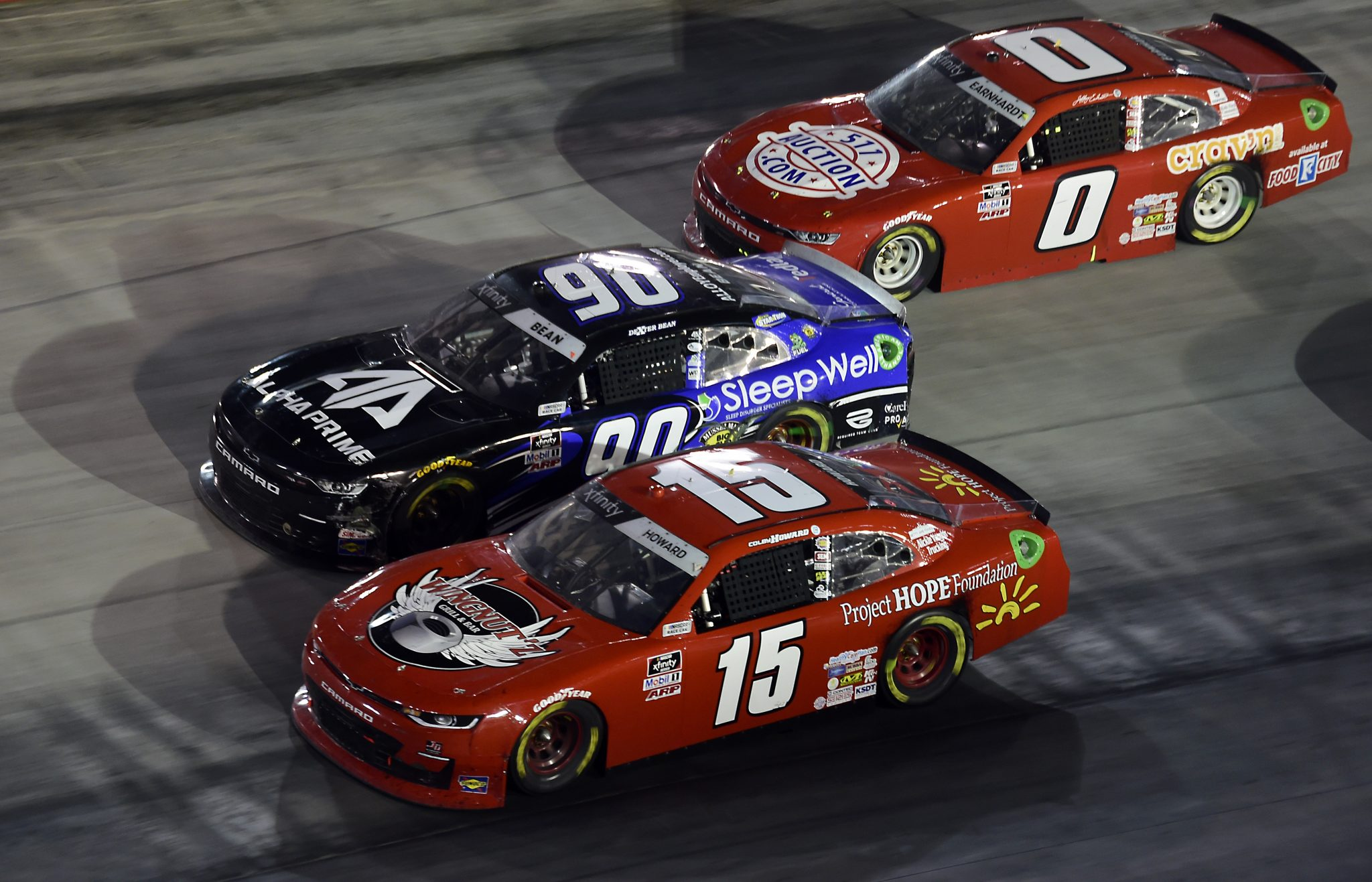 BRISTOL, TENNESSEE - SEPTEMBER 18: Colby Howard, driver of the #15 Project Hope Foundation Chevrolet, Dexter Bean, driver of the #90 Sleep Well/Alpha Prime Chevrolet, and Jeffrey Earnhardt, driver of the #0 511Auction.com Chevrolet, race during the NASCAR Xfinity Series Food City 300 at Bristol Motor Speedway on September 18, 2020 in Bristol, Tennessee. (Photo by Jared C. Tilton/Getty Images)   Getty Images