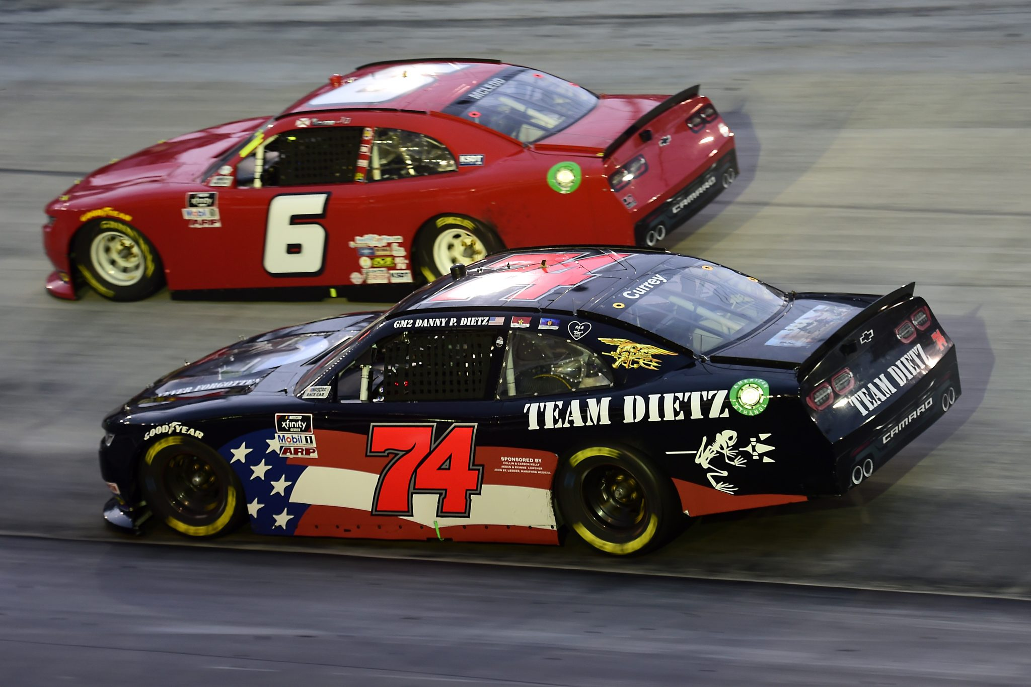 BRISTOL, TENNESSEE - SEPTEMBER 18: Bayley Currey, driver of the #74 Team Dietz Chevrolet, and BJ McLeod, driver of the #6 JD Motorsports Chevrolet, race during the NASCAR Xfinity Series Food City 300 at Bristol Motor Speedway on September 18, 2020 in Bristol, Tennessee. (Photo by Jared C. Tilton/Getty Images) | Getty Images