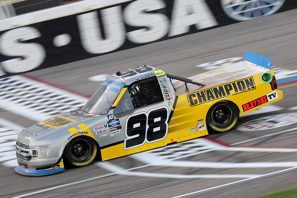 LAS VEGAS, NEVADA - SEPTEMBER 25: Grant Enfinger, driver of the #98 Champoin/Curb Records Ford, drives during the NASCAR Gander RV & Outdoors Truck Series World of Westgate 200 at Las Vegas Motor Speedway on September 25, 2020 in Las Vegas, Nevada. (Photo by Chris Graythen/Getty Images) | Getty Images