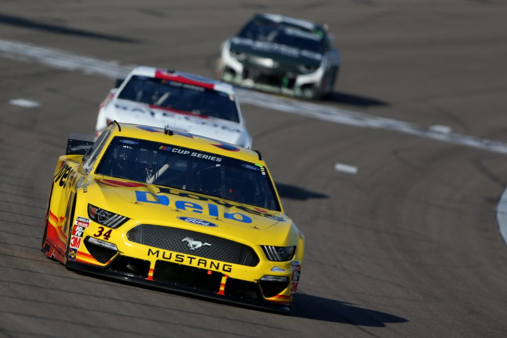 LAS VEGAS, NEVADA - SEPTEMBER 27: Michael McDowell, driver of the #34 Love's Travel Stops Ford, leads a pack of cars during the NASCAR Cup Series South Point 400 at Las Vegas Motor Speedway on September 27, 2020 in Las Vegas, Nevada. (Photo by Brian Lawdermilk/Getty Images) | Getty Images