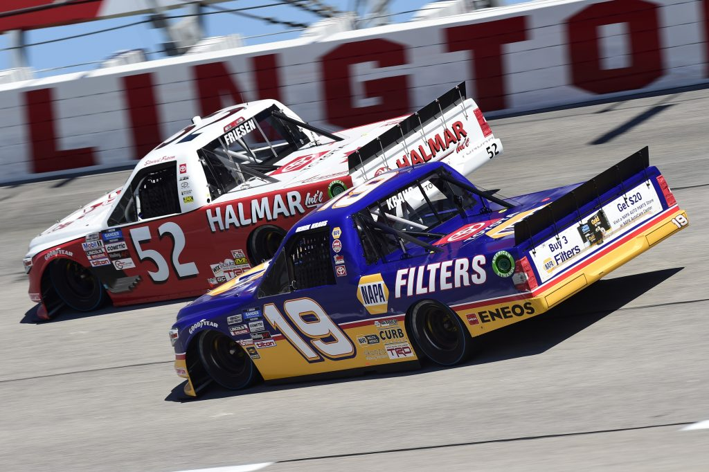 DARLINGTON, SOUTH CAROLINA - SEPTEMBER 06: Derek Kraus, driver of the #19 Ron Hornaday Throwback Toyota, and Stewart Friesen, driver of the #52 Halmar Racing To Beat Hunger Toyota, race during the NASCAR Gander Outdoors Truck Series South Carolina Education Lottery 200 at Darlington Raceway on September 06, 2020 in Darlington, South Carolina. (Photo by Jared C. Tilton/Getty Images) | Getty Images