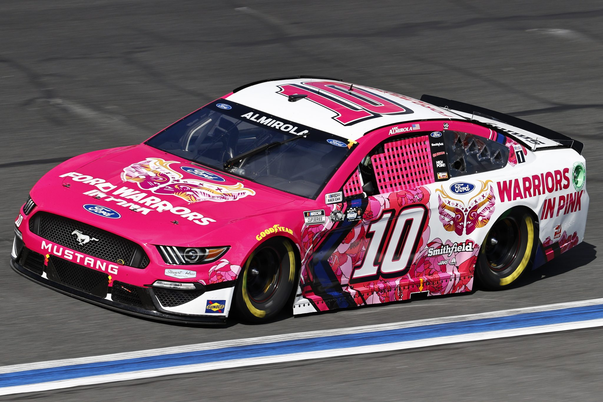 CONCORD, NORTH CAROLINA - OCTOBER 10: Aric Almirola, driver of the #10 Ford Warriors in Pink Ford, drives during the NASCAR Cup Series Bank of America ROVAL 400 at Charlotte Motor Speedway on October 10, 2021 in Concord, North Carolina. (Photo by Jared C. Tilton/Getty Images) | Getty Images