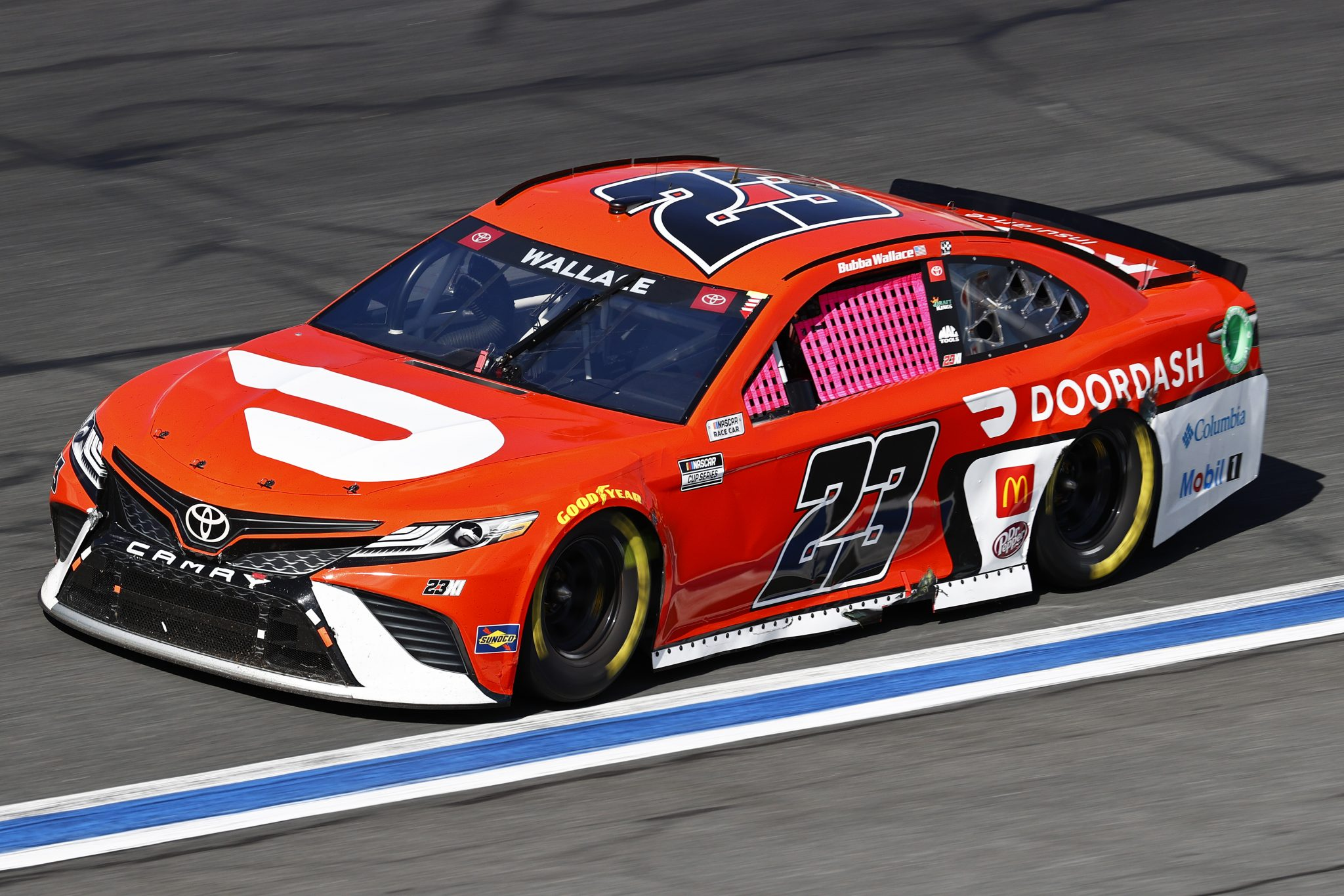 CONCORD, NORTH CAROLINA - OCTOBER 10: Bubba Wallace, driver of the #23 Door Dash Toyota, drives during the NASCAR Cup Series Bank of America ROVAL 400 at Charlotte Motor Speedway on October 10, 2021 in Concord, North Carolina. (Photo by Jared C. Tilton/Getty Images) | Getty Images