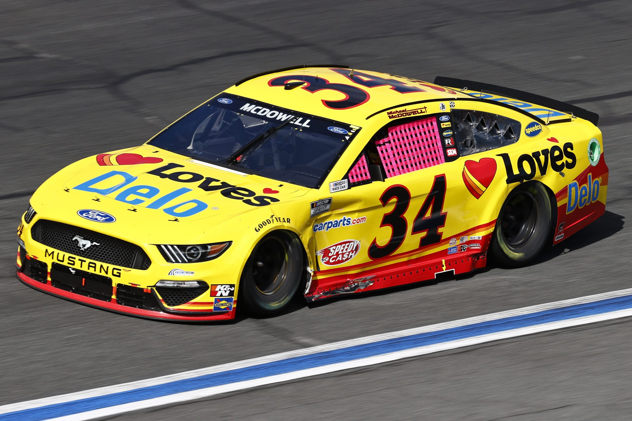 CONCORD, NORTH CAROLINA - OCTOBER 10: Michael McDowell, driver of the #34 Love's Travel Stops Ford, drives during the NASCAR Cup Series Bank of America ROVAL 400 at Charlotte Motor Speedway on October 10, 2021 in Concord, North Carolina. (Photo by Jared C. Tilton/Getty Images) | Getty Images