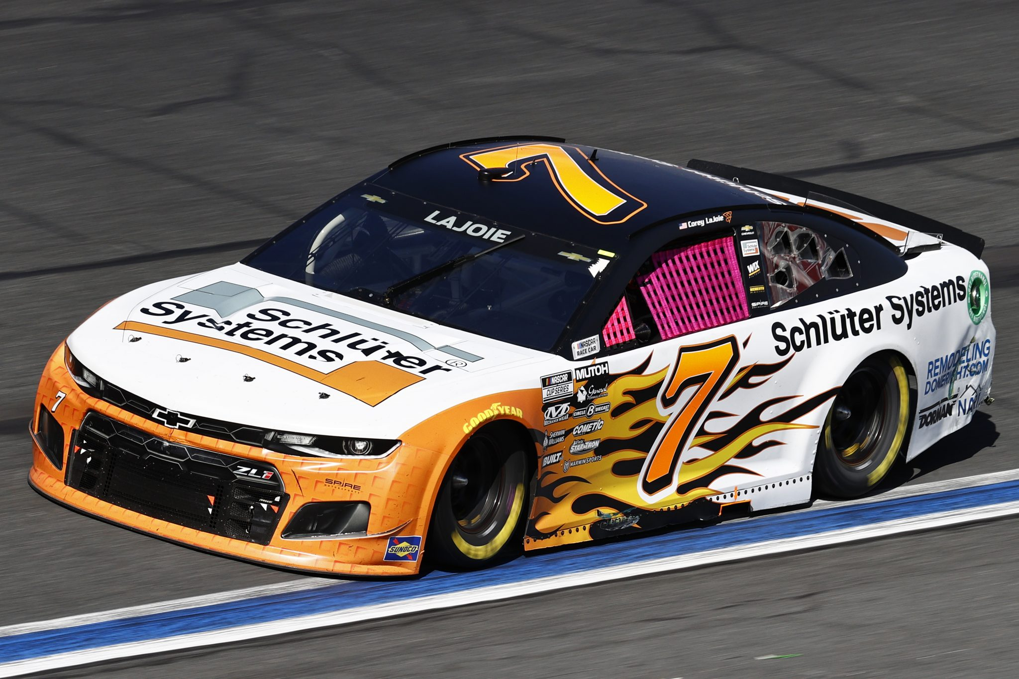 CONCORD, NORTH CAROLINA - OCTOBER 10: Corey LaJoie, driver of the #7 Schluter Systems Chevrolet, drives during the NASCAR Cup Series Bank of America ROVAL 400 at Charlotte Motor Speedway on October 10, 2021 in Concord, North Carolina. (Photo by Jared C. Tilton/Getty Images) | Getty Images