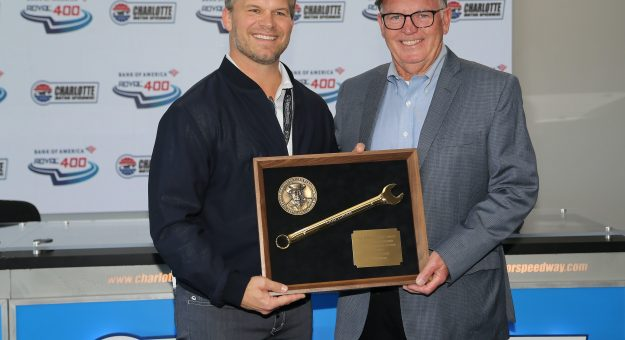 Charlotte Motor Speedway President and CEO Marcus Smith presents the Smokey Yunick mechanic award to Gary Nelson during the Bank of America Roval 400 at Charlotte Motor Speedway in Concord, NC, October 10, 2021.  (HHP/Tim Parks)