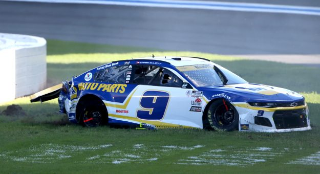 CONCORD, NORTH CAROLINA - OCTOBER 10: Chase Elliott, driver of the #9 NAPA Auto Parts Chevrolet, sits in the grass after an on-track incident during the NASCAR Cup Series Bank of America ROVAL 400 at Charlotte Motor Speedway on October 10, 2021 in Concord, North Carolina. (Photo by Brian Lawdermilk/Getty Images) | Getty Images