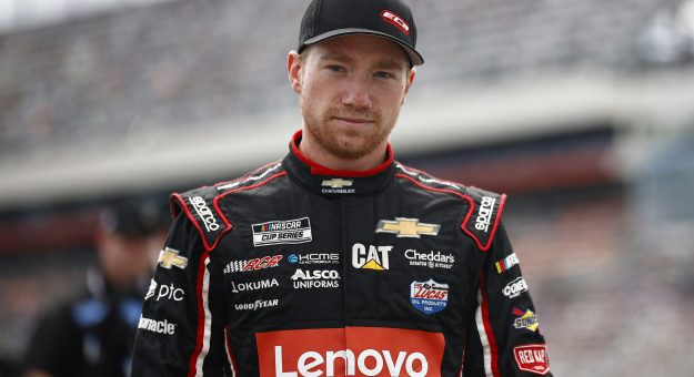 CONCORD, NORTH CAROLINA - OCTOBER 10: Tyler Reddick, driver of the #8 Lenovo Chevrolet, walks the grid prior to the NASCAR Cup Series Bank of America ROVAL 400 at Charlotte Motor Speedway on October 10, 2021 in Concord, North Carolina. (Photo by Jared C. Tilton/Getty Images) | Getty Images