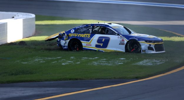 CONCORD, NORTH CAROLINA - OCTOBER 10: Chase Elliott, driver of the #9 NAPA Auto Parts Chevrolet, sits in the grass after an on-track incident during the NASCAR Cup Series Bank of America ROVAL 400 at Charlotte Motor Speedway on October 10, 2021 in Concord, North Carolina. (Photo by Brian Lawdermilk/Getty Images)   Getty Images