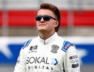 CONCORD, NORTH CAROLINA - OCTOBER 09: Stefan Parsons, driver of the #78 SOKAL Digital Chevrolet, walks the grid prior to the NASCAR Xfinity Series Drive for the Cure 250 presented by Blue Cross Blue Shield of North Carolina at Charlotte Motor Speedway on October 09, 2021 in Concord, North Carolina. (Photo by Jared C. Tilton/Getty Images)   Getty Images