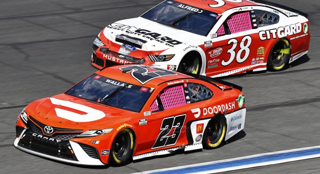 CONCORD, NORTH CAROLINA - OCTOBER 10: Bubba Wallace, driver of the #23 Door Dash Toyota, and Anthony Alfredo, driver of the #38 CITGARD Ford, race during the NASCAR Cup Series Bank of America ROVAL 400 at Charlotte Motor Speedway on October 10, 2021 in Concord, North Carolina. (Photo by Jared C. Tilton/Getty Images)   Getty Images