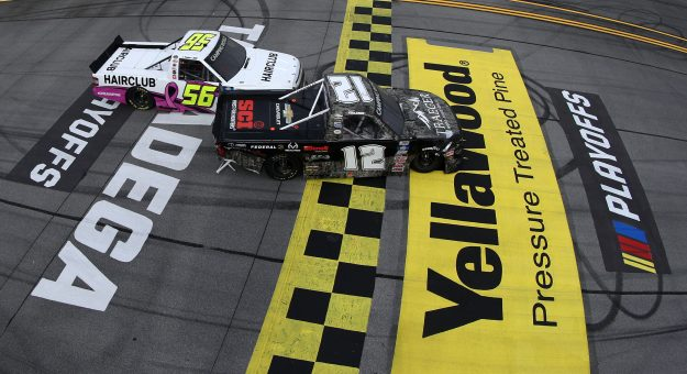 TALLADEGA, ALABAMA - OCTOBER 02: Tate Fogleman, driver of the #12 Traeger Grills Chevrolet, is involved in an on-track incident with Tyler Hill, driver of the #56 HairClub Chevrolet, at the finish line after winning the NASCAR Camping World Truck Series Chevrolet Silverado 250 at Talladega Superspeedway on October 02, 2021 in Talladega, Alabama. (Photo by Sean Gardner/Getty Images)   Getty Images