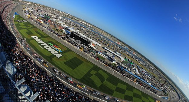 DAYTONA BEACH, FLORIDA - FEBRUARY 17: Cars race during the NASCAR Cup Series 62nd Annual Daytona 500 at Daytona International Speedway on February 17, 2020 in Daytona Beach, Florida. (Photo by Mike Ehrmann/Getty Images) | Getty Images
