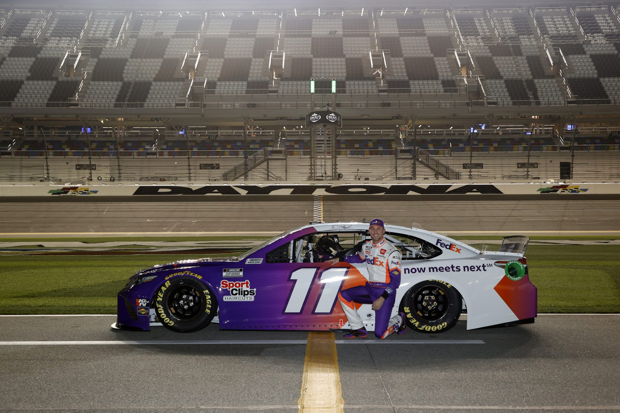 DAYTONA BEACH, FLORIDA - FEBRUARY 10: Denny Hamlin, driver of the #11 FedEx Toyota, poses for photos during qualifying for the NASCAR Cup Series 63rd Annual Daytona 500 at Daytona International Speedway on February 10, 2021 in Daytona Beach, Florida. (Photo by Jared C. Tilton/Getty Images) | Getty Images