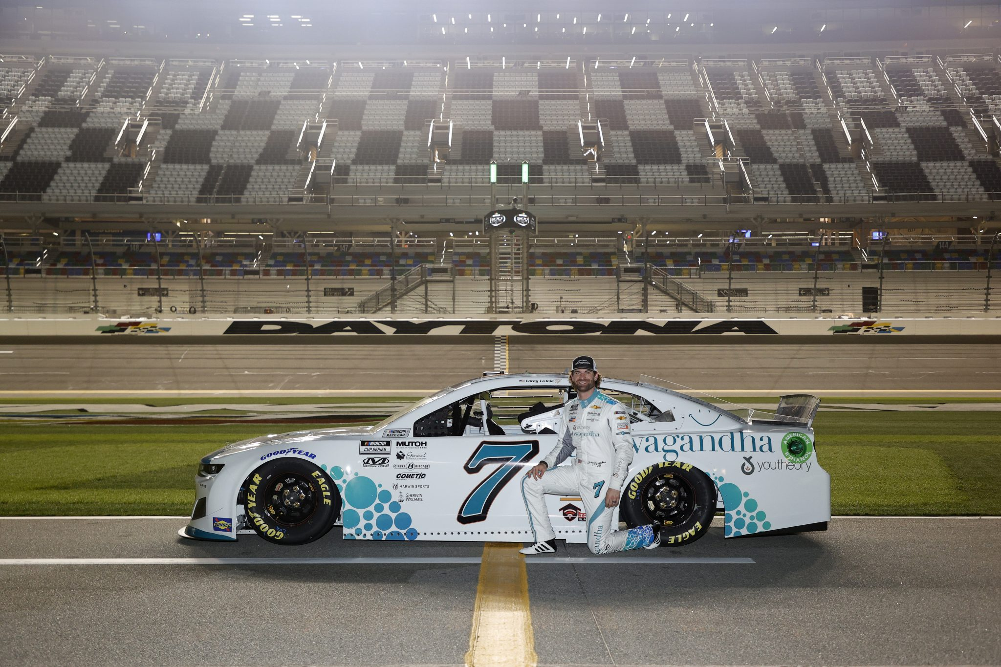 DAYTONA BEACH, FLORIDA - FEBRUARY 10: Corey LaJoie, driver of the #7 Youtheory Chevrolet, poses for photos during qualifying for the NASCAR Cup Series 63rd Annual Daytona 500 at Daytona International Speedway on February 10, 2021 in Daytona Beach, Florida. (Photo by Jared C. Tilton/Getty Images) | Getty Images