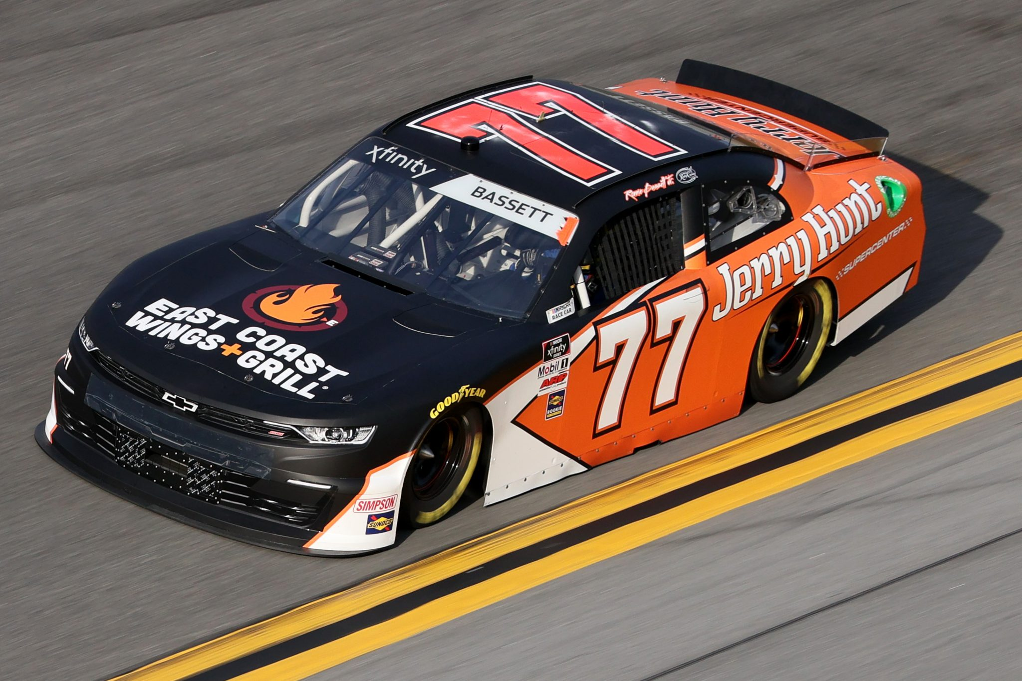 DAYTONA BEACH, FLORIDA - FEBRUARY 12: Ronnie Bassett Jr., driver of the #77 Jerry Hunt/East Coast Wings Chevrolet, practices for the NASCAR Xfinity Series Beef. It's What's For Dinner. 300 at Daytona International Speedway on February 12, 2021 in Daytona Beach, Florida. (Photo by James Gilbert/Getty Images) | Getty Images