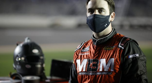 DAYTONA BEACH, FLORIDA - FEBRUARY 10: Garrett Smithley, driver of the #13 Trophy Tractor Ford,waits on the grid during qualifying for the NASCAR Cup Series 63rd Annual Daytona 500 at Daytona International Speedway on February 10, 2021 in Daytona Beach, Florida. (Photo by Chris Graythen/Getty Images) | Getty Images