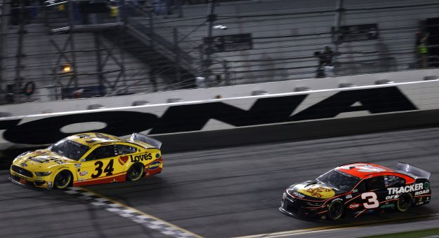 DAYTONA BEACH, FLORIDA - FEBRUARY 14: Michael McDowell, driver of the #34 Love's Travel Stops Ford, crosses the finish line to win during the NASCAR Cup Series 63rd Annual Daytona 500 at Daytona International Speedway on February 14, 2021 in Daytona Beach, Florida. (Photo by Jared C. Tilton/Getty Images) | Getty Images
