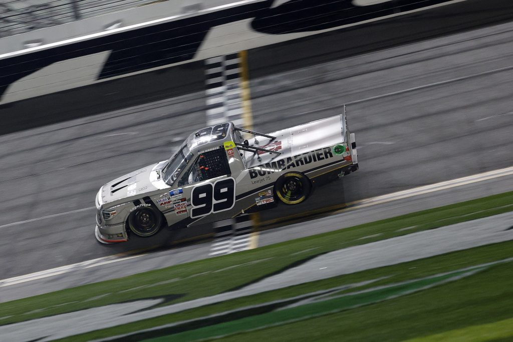 DAYTONA BEACH, FLORIDA - FEBRUARY 19: Ben Rhodes, driver of the #99 Bombardier LearJet 75 Toyota, crosses the finish line to win the NASCAR Camping World Truck Series BrakeBest Brake Pads 159 At Daytona Presented by O'Reilly at Daytona International Speedway on February 19, 2021 in Daytona Beach, Florida. (Photo by Chris Graythen/Getty Images) | Getty Images