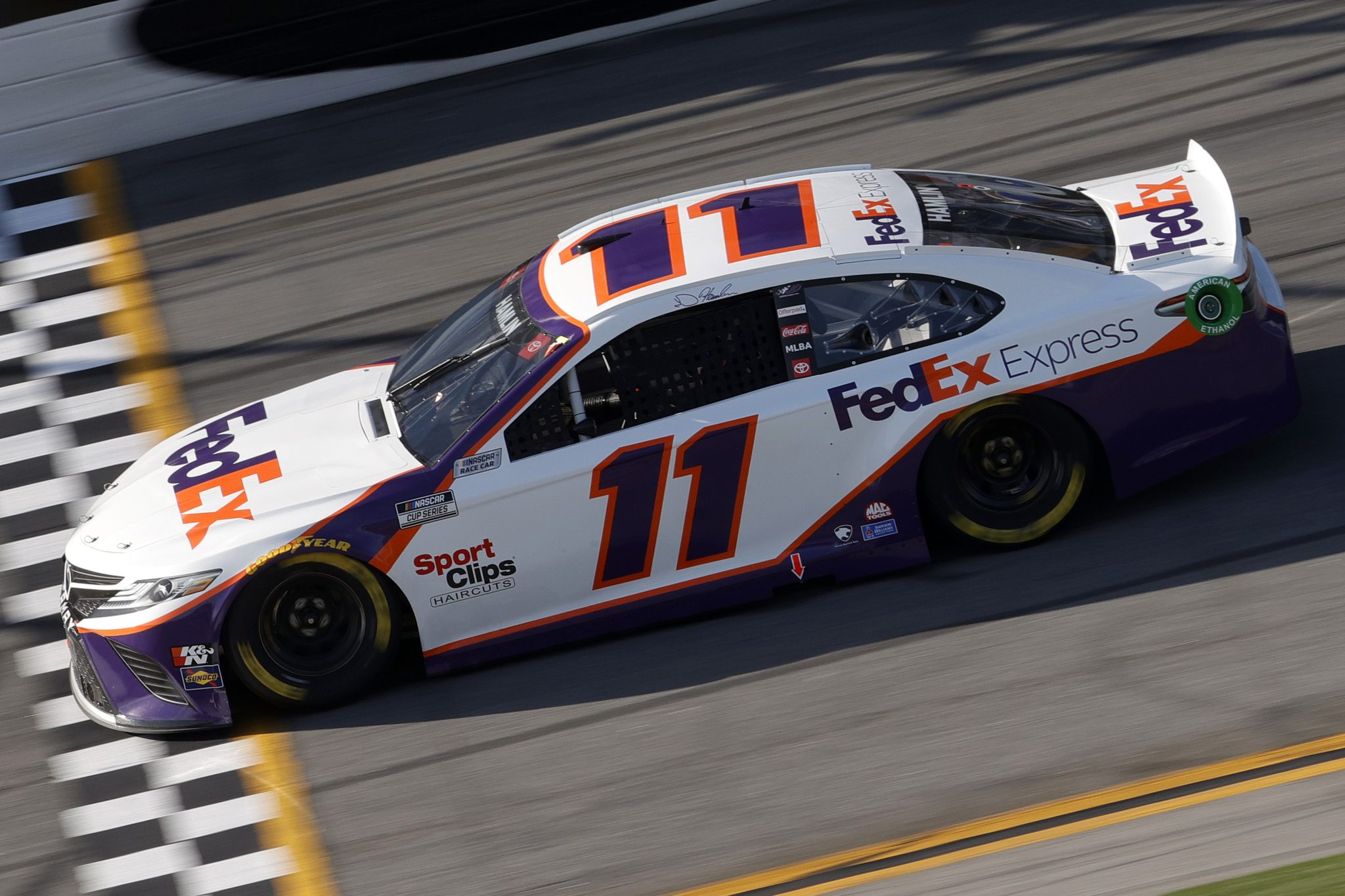 DAYTONA BEACH, FLORIDA - FEBRUARY 21: Denny Hamlin, driver of the #11 FedEx Express Toyota, drives during the NASCAR Cup Series O'Reilly Auto Parts 253 at Daytona International Speedway on February 21, 2021 in Daytona Beach, Florida. (Photo by Chris Graythen/Getty Images) | Getty Images