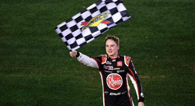 DAYTONA BEACH, FLORIDA - FEBRUARY 21: Christopher Bell, driver of the #20 Rheem Toyota, celebrates with the checkered flag after winning the NASCAR Cup Series O'Reilly Auto Parts 253 at Daytona International Speedway on February 21, 2021 in Daytona Beach, Florida. (Photo by James Gilbert/Getty Images) | Getty Images