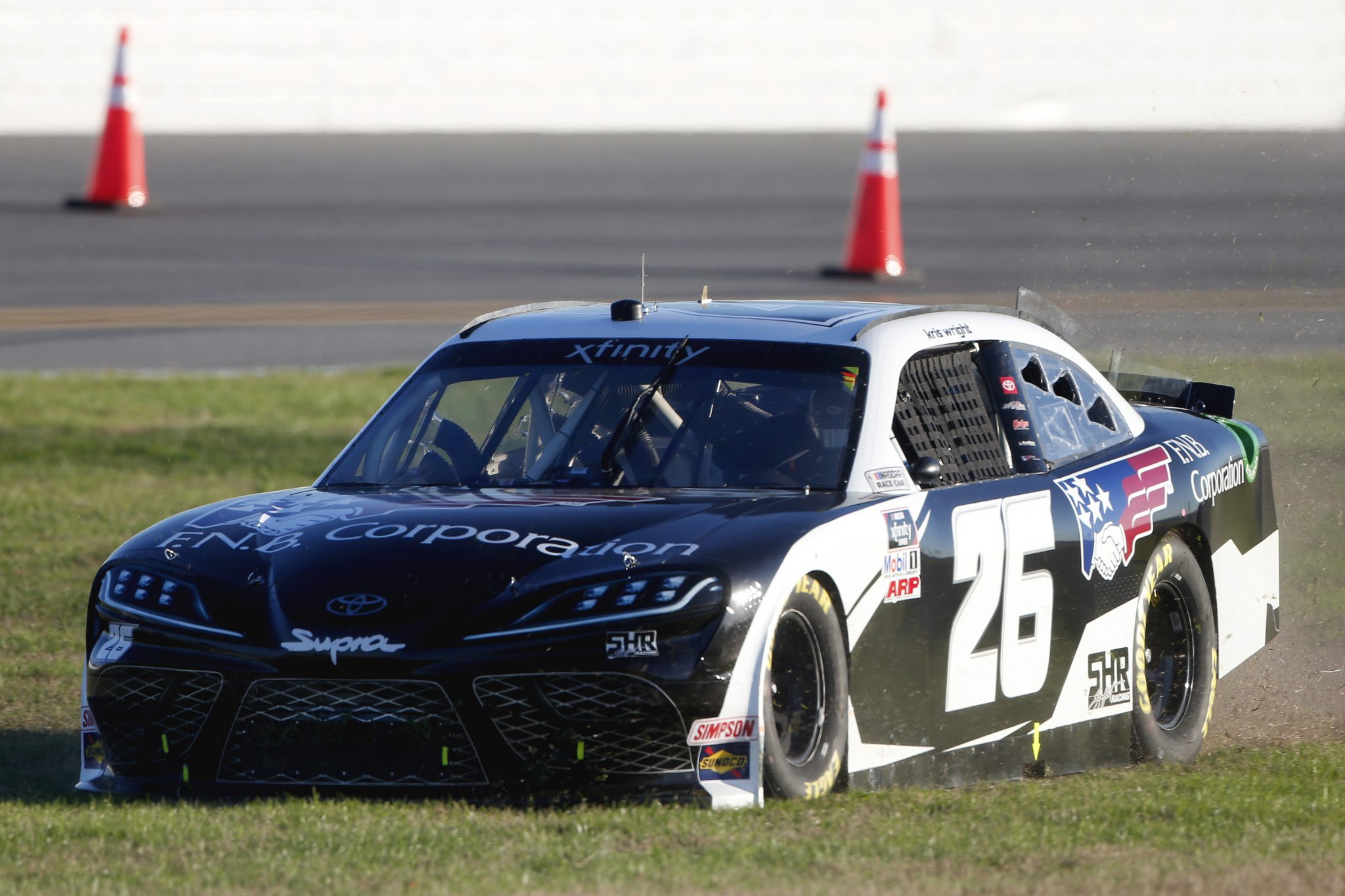 DAYTONA BEACH, FLORIDA - FEBRUARY 20: Kris Wright, driver of the #26 F.N.B. Corporation Toyota, spins into the grass during the NASCAR Xfinity Super Start Batteries 188 At Daytona Presented by O'Reilly at Daytona International Speedway on February 20, 2021 in Daytona Beach, Florida. (Photo by Brian Lawdermilk/Getty Images) | Getty Images
