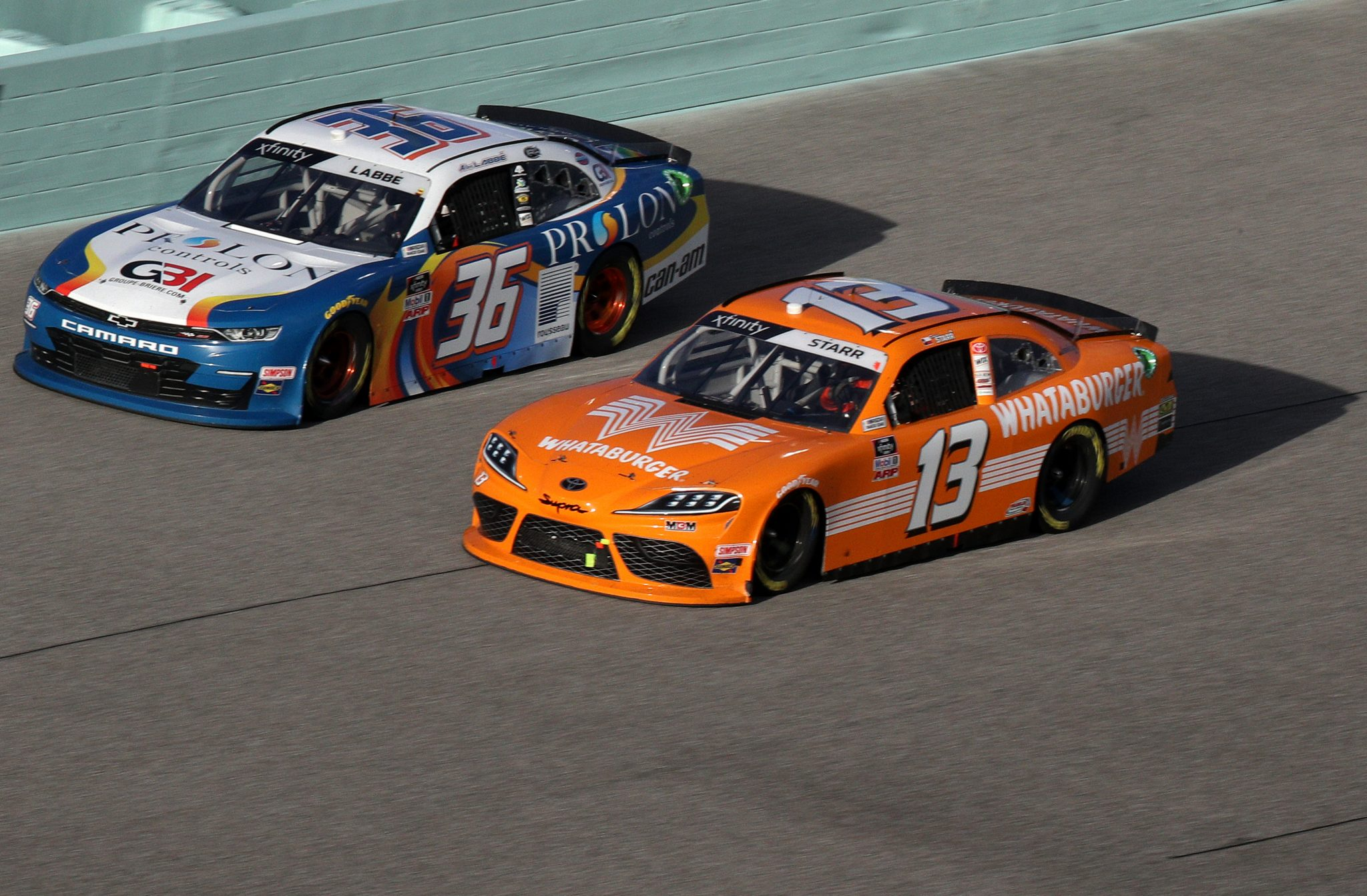 HOMESTEAD, FLORIDA - FEBRUARY 27: Alex Labbe, driver of the #36 Prolon/rousseau/Silver Wax Chevrolet, and David Starr, driver of the #13 Ford, race during the NASCAR Xfinity Series Contender Boats 250 at Homestead-Miami Speedway on February 27, 2021 in Homestead, Florida. (Photo by Sean Gardner/Getty Images) | Getty Images