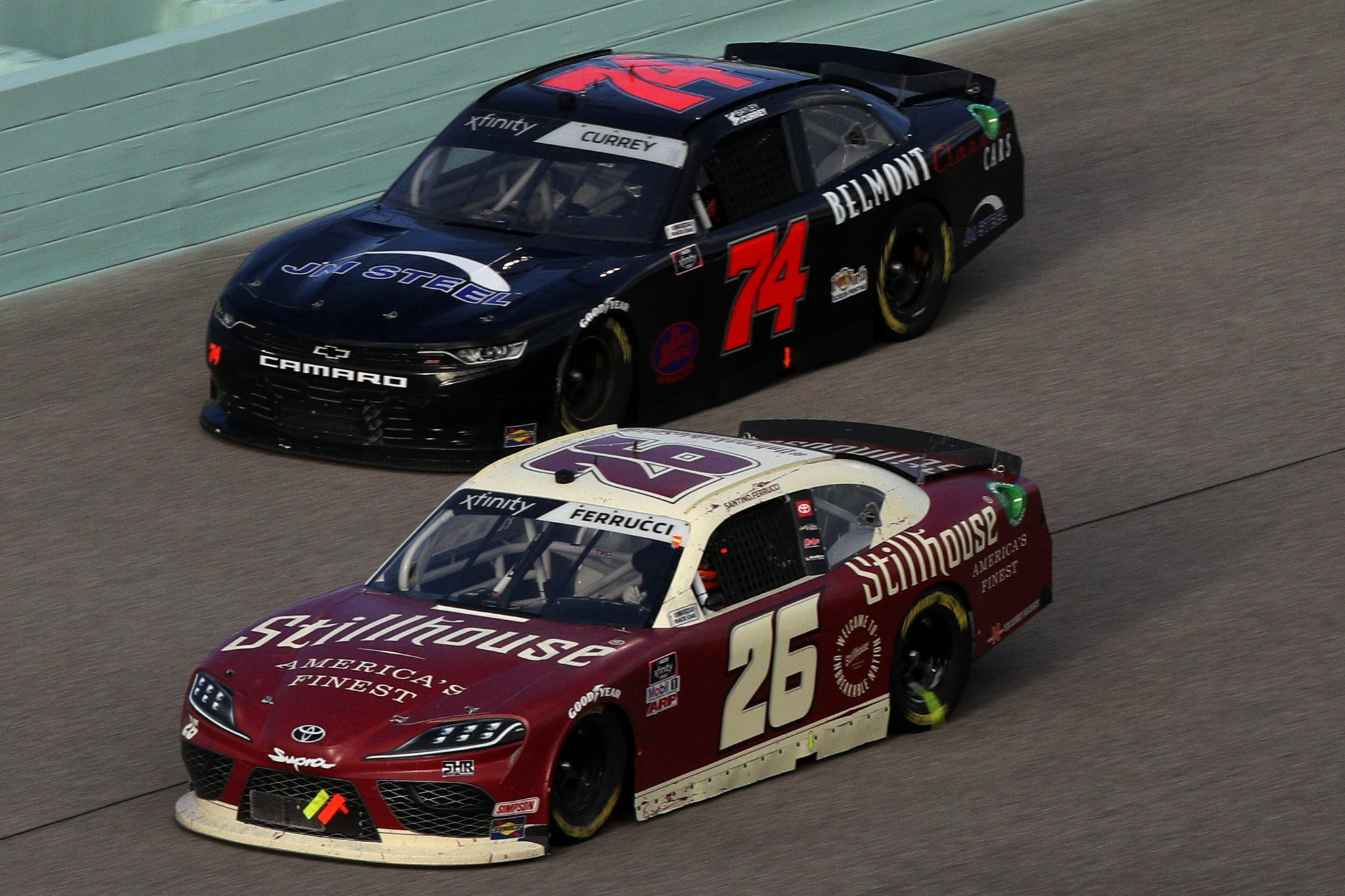 HOMESTEAD, FLORIDA - FEBRUARY 27: Santino Ferrucci, driver of the #26 Stillhouse Whiskey Toyota, and Bayley Currey, driver of the #74 Chevrolet, race during the NASCAR Xfinity Series Contender Boats 250 at Homestead-Miami Speedway on February 27, 2021 in Homestead, Florida. (Photo by Sean Gardner/Getty Images) | Getty Images