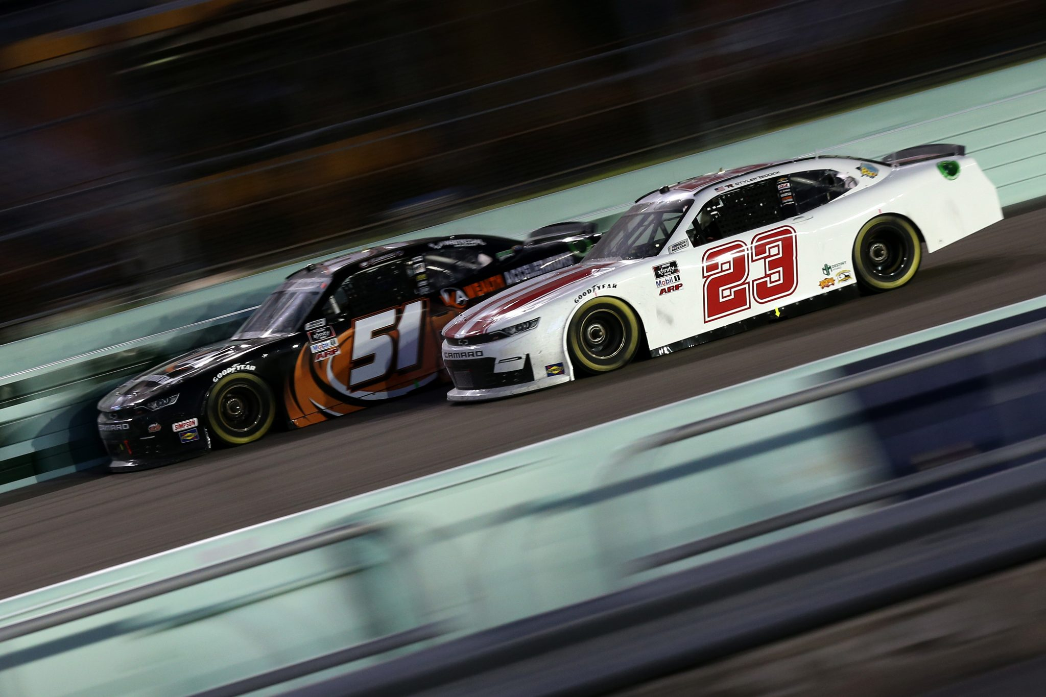 HOMESTEAD, FLORIDA - FEBRUARY 27: Tyler Reddick, driver of the #23 Chevrolet, and Jeremy Clements, driver of the #51 Wealth Accelerators Chevrolet, race during the NASCAR Xfinity Series Contender Boats 250 at Homestead-Miami Speedway on February 27, 2021 in Homestead, Florida. (Photo by Sean Gardner/Getty Images) | Getty Images