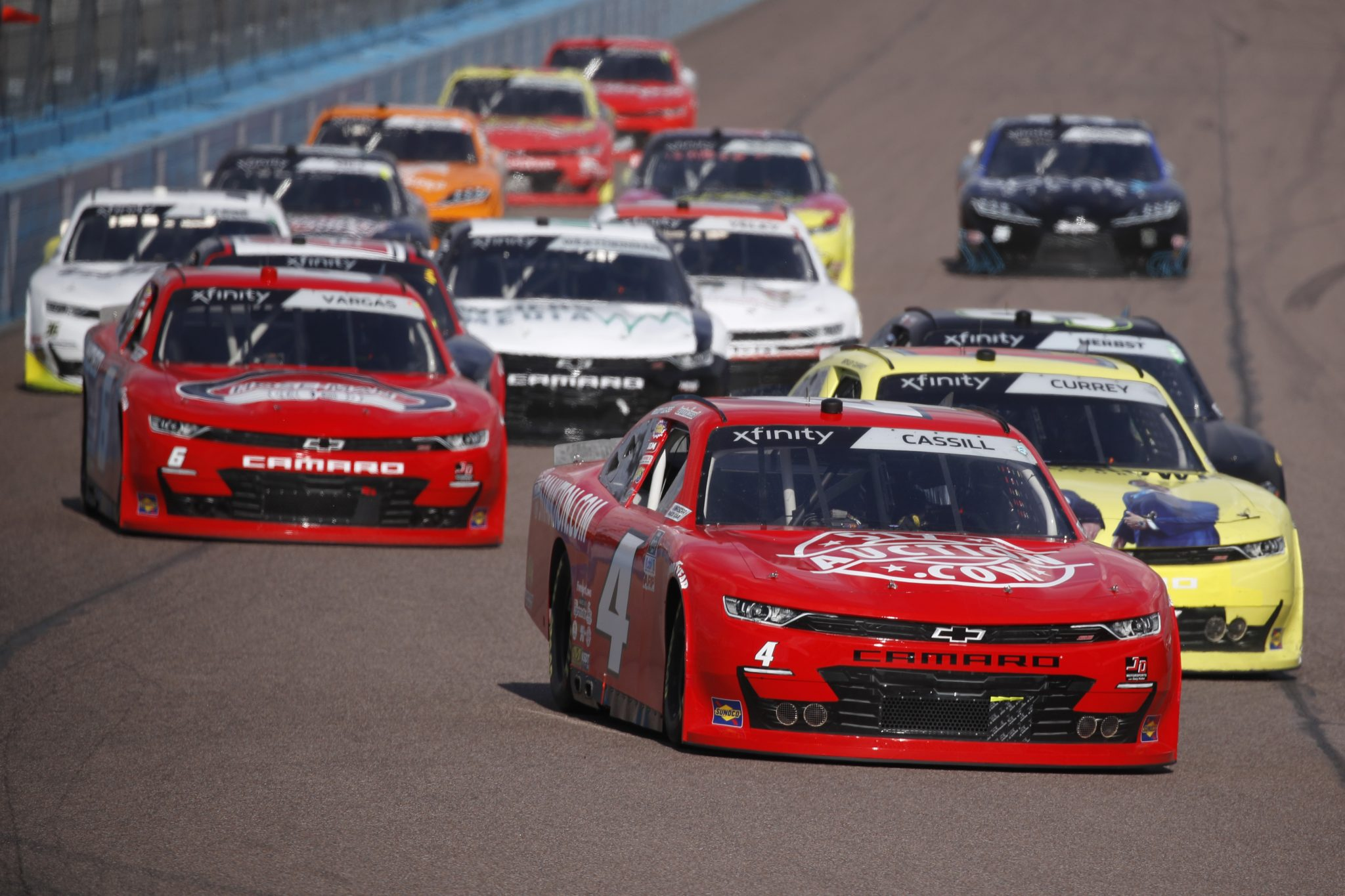 AVONDALE, ARIZONA - MARCH 13: Landon Cassill, driver of the #4 511Auction.com Chevrolet, leads the field during the NASCAR Xfinity Series Call 811 Before You Dig 200 presented by Arizona 811 at Phoenix Raceway on March 13, 2021 in Avondale, Arizona. (Photo by Christian Petersen/Getty Images) | Getty Images