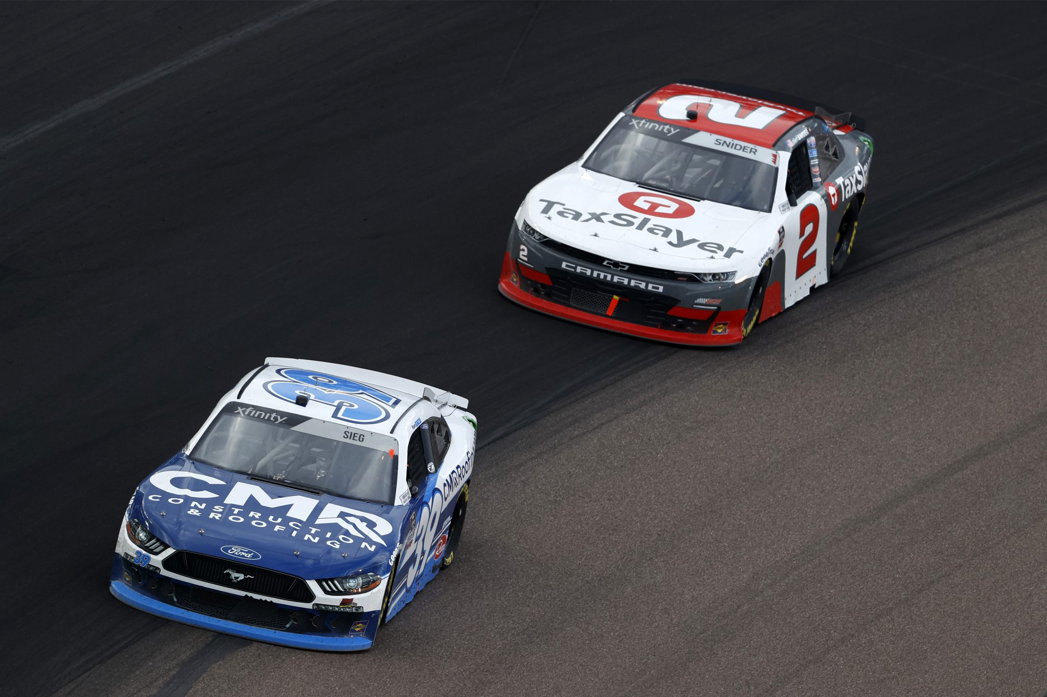 AVONDALE, ARIZONA - MARCH 13: Ryan Sieg, driver of the #39 CMR Construction and Roofing Ford, and Myatt Snider, driver of the #2 TaxSlayer Chevrolet, race during the NASCAR Xfinity Series Call 811 Before You Dig 200 presented by Arizona 811 at Phoenix Raceway on March 13, 2021 in Avondale, Arizona. (Photo by Christian Petersen/Getty Images) | Getty Images