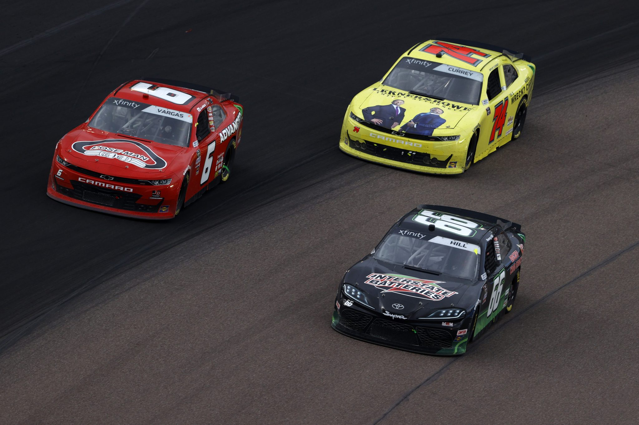 AVONDALE, ARIZONA - MARCH 13: Ryan Vargas, driver of the #6 Hose-Man/Advanced Masonry Chevrolet, Timmy Hill, driver of the #66 LasVegas.net Toyota, and Ty Gibbs, driver of the #54 PristineAuction.com Toyota, race during the NASCAR Xfinity Series Call 811 Before You Dig 200 presented by Arizona 811 at Phoenix Raceway on March 13, 2021 in Avondale, Arizona. (Photo by Christian Petersen/Getty Images) | Getty Images