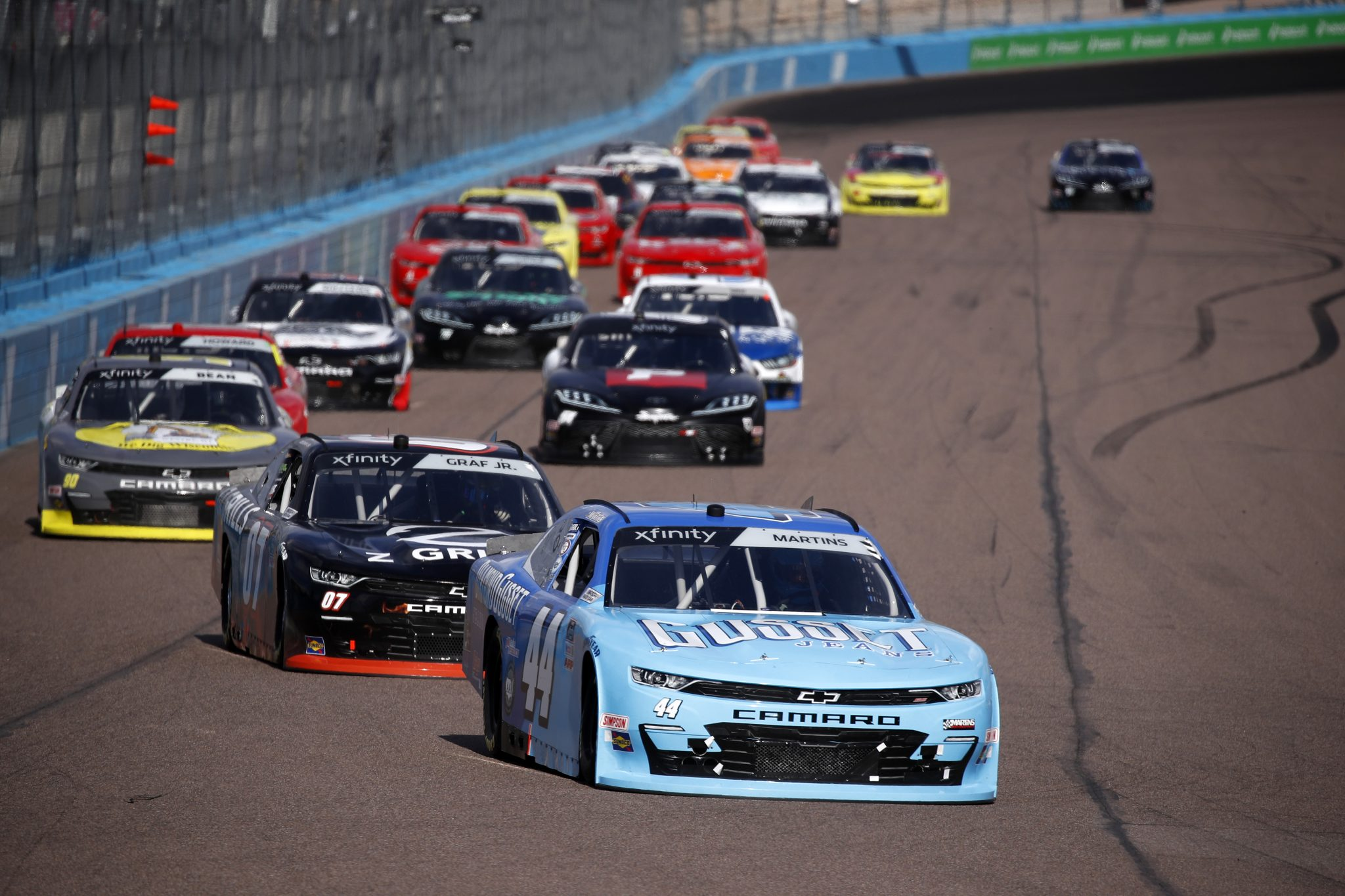 AVONDALE, ARIZONA - MARCH 13: Tommy Joe Martins, driver of the #44 Diamon Gusset Jeans Chevrolet, leads the field during the NASCAR Xfinity Series Call 811 Before You Dig 200 presented by Arizona 811 at Phoenix Raceway on March 13, 2021 in Avondale, Arizona. (Photo by Christian Petersen/Getty Images) | Getty Images