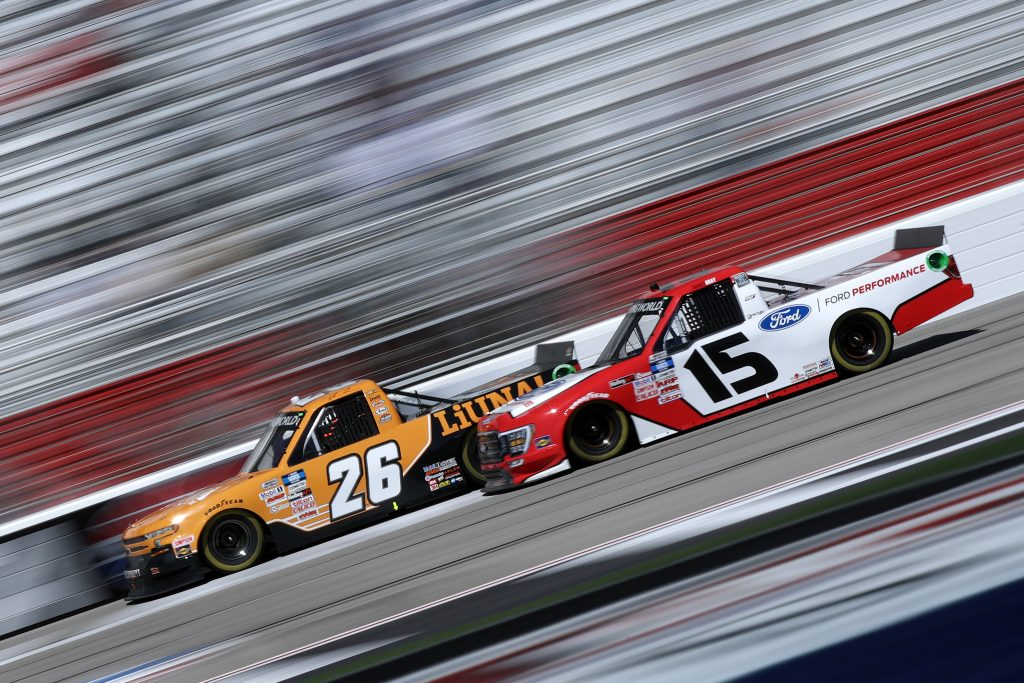 HAMPTON, GEORGIA - MARCH 20: Tyler Ankrum, driver of the #26 LiUNA! Chevrolet, and Tanner Gray, driver of the #15 Ford Performance Ford, race during the NASCAR Camping World Truck Series Fr8Auctions 200 at Atlanta Motor Speedway on March 20, 2021 in Hampton, Georgia. (Photo by Sean Gardner/Getty Images) | Getty Images