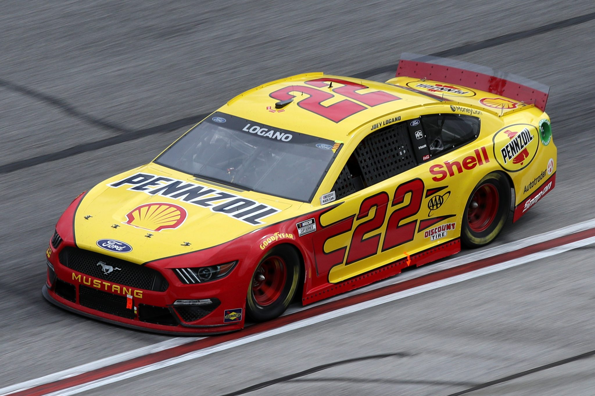 HAMPTON, GEORGIA - MARCH 21: Joey Logano, driver of the #22 Shell Pennzoil Ford, drives during the NASCAR Cup Series Folds of Honor QuikTrip 500 at Atlanta Motor Speedway on March 21, 2021 in Hampton, Georgia. (Photo by Sean Gardner/Getty Images) | Getty Images