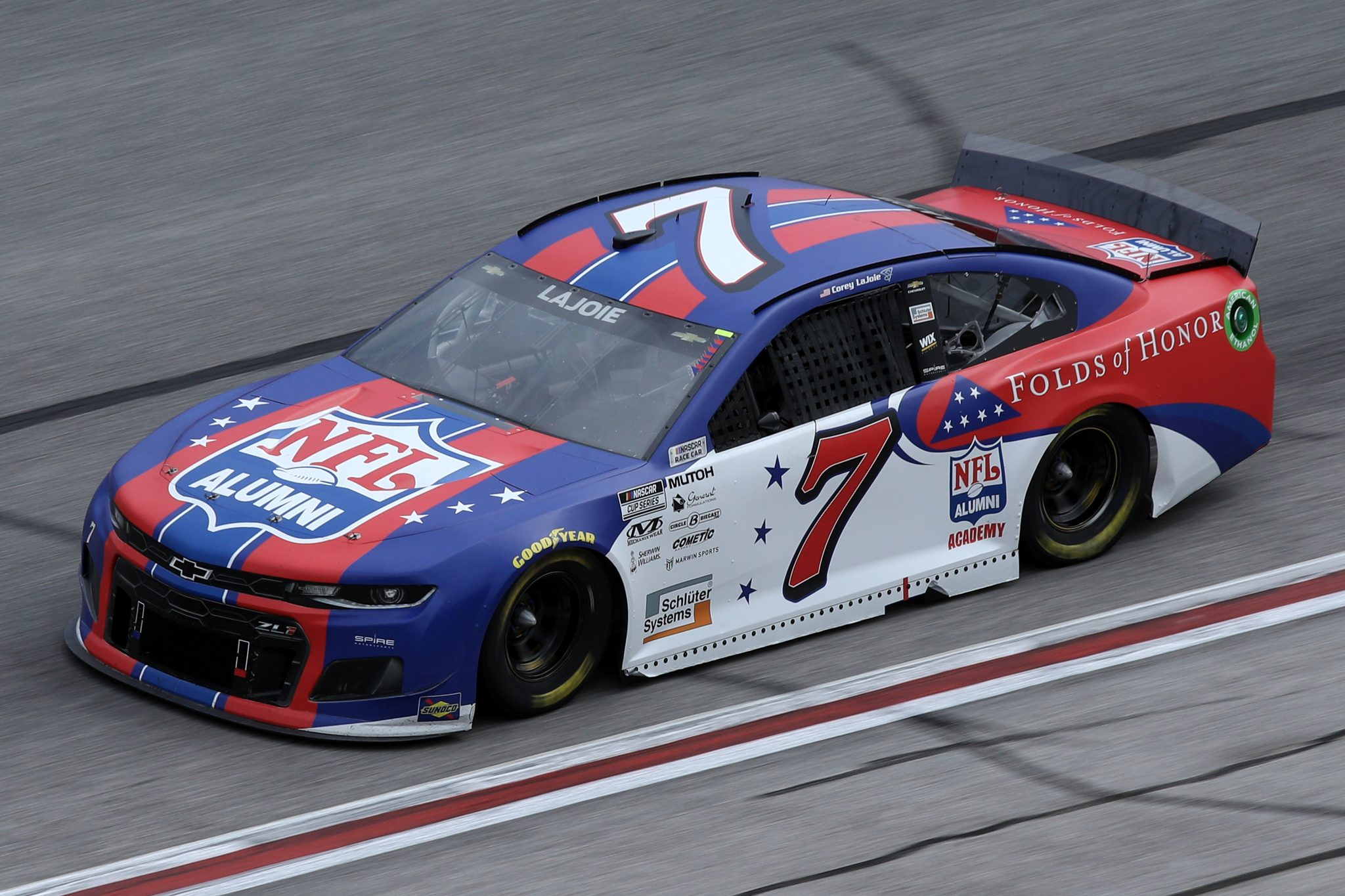 HAMPTON, GEORGIA - MARCH 21: Corey LaJoie, driver of the #7 NFL Alumni/Folds of Honor Chevrolet, drives during the NASCAR Cup Series Folds of Honor QuikTrip 500 at Atlanta Motor Speedway on March 21, 2021 in Hampton, Georgia. (Photo by Sean Gardner/Getty Images) | Getty Images