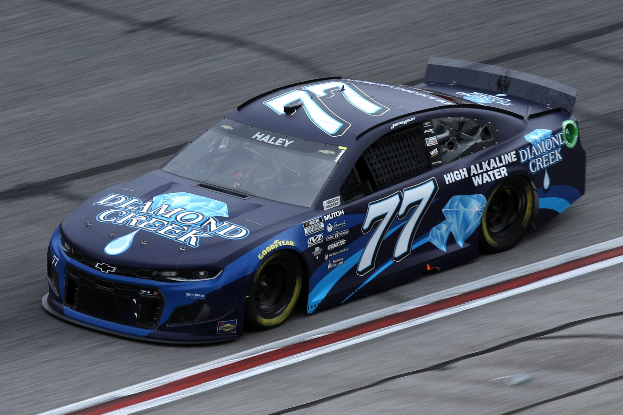 HAMPTON, GEORGIA - MARCH 21: Justin Haley, driver of the #77 Diamond Creek Water Chevrolet, drives during the NASCAR Cup Series Folds of Honor QuikTrip 500 at Atlanta Motor Speedway on March 21, 2021 in Hampton, Georgia. (Photo by Sean Gardner/Getty Images) | Getty Images