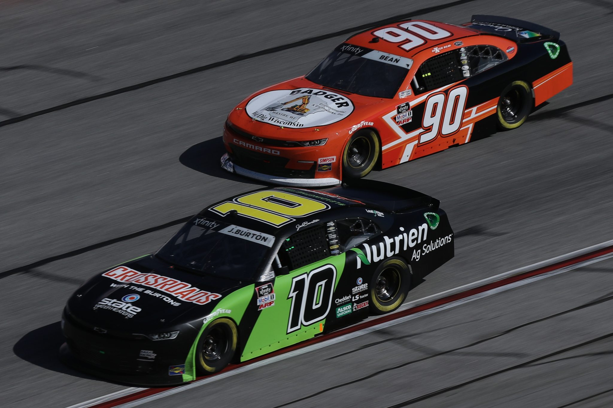 HAMPTON, GEORGIA - MARCH 20: Jeb Burton, driver of the #10 Nutrien Chevrolet, and Dexter Bean, driver of the #90 Badger Environmental Chevrolet, race during the NASCAR Xfinity Series EchoPark 250 at Atlanta Motor Speedway on March 20, 2021 in Hampton, Georgia. (Photo by Sean Gardner/Getty Images) | Getty Images