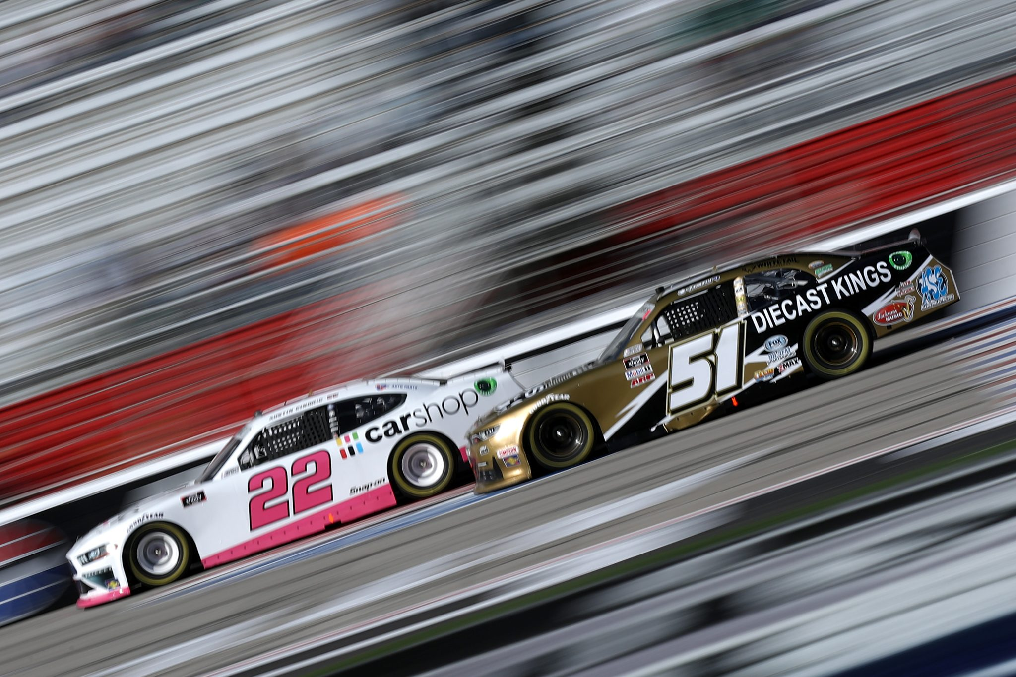 HAMPTON, GEORGIA - MARCH 20: Jeremy Clements, driver of the #51 Diecast Kings Chevrolet, and Austin Cindric, driver of the #22 Car Shop Ford, race during the NASCAR Xfinity Series EchoPark 250 at Atlanta Motor Speedway on March 20, 2021 in Hampton, Georgia. (Photo by Sean Gardner/Getty Images) | Getty Images