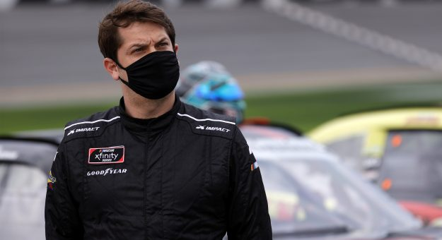 DAYTONA BEACH, FLORIDA - FEBRUARY 13: Landon Cassill, driver of the #4 Blue Emu Chevrolet, waits on the grid prior to the NASCAR Xfinity Series Beef. It's What's For Dinner. 300 at Daytona International Speedway on February 13, 2021 in Daytona Beach, Florida. (Photo by Jared C. Tilton/Getty Images)   Getty Images
